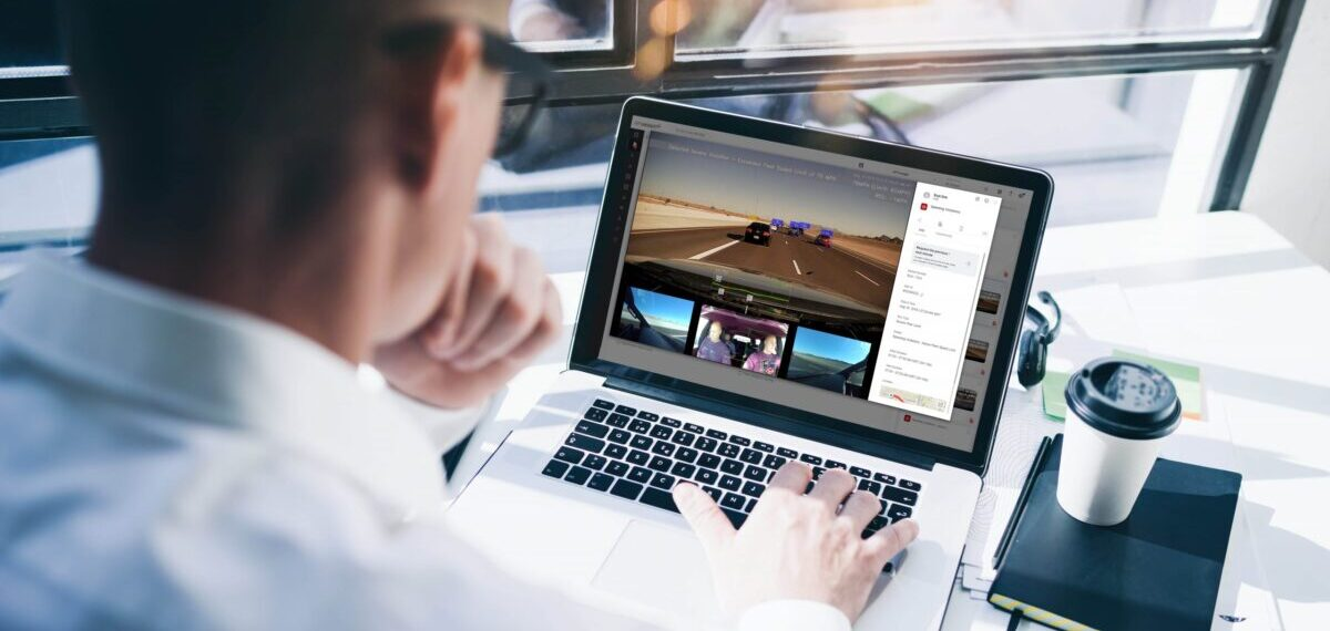 Fleet manager reviewing video
